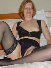 Shaved redhead wife in lingerie spreads