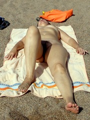 Salome at the beach Nude and exposed..