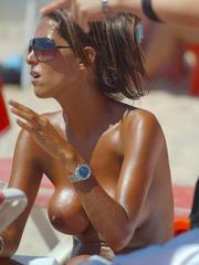 Tanned wife with round breasts topless